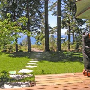 North Lake Tahoe lakefront vacation cabin rental back yard sunny deck