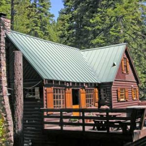 North Tahoe log cabin vacation rental large sunny deck with a hot tub
